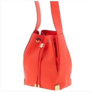 Vince Camuto drawstring bucket bag- orange/red